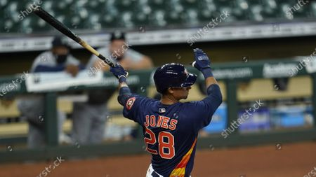 Houston Astros' Taylor Jones bats against the Seattle Mariners during the fourth inning of a baseball game, in Houston