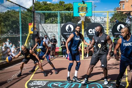 Stock Picture of French basketball player Tony Parker (L) and French judo champion Teddy Riner (2R) take part in a 'four years to go' Basketball exhibition tournament  in Paris, France, 26 July 2020.