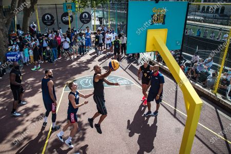 French basketball player Tony Parker (C) and French judo champion Teddy Riner (L) take part in a 'four years to go' Basketball exhibition tournament  in Paris, France, 26 July 2020.