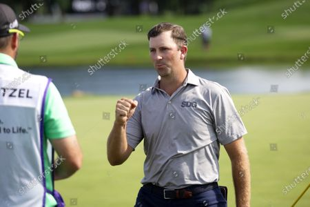 Michael Thompson celebrates after winning the 3M Open golf tournament in Blaine, Minn