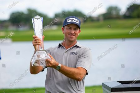 Michael Thompson holds the trophy after winning the 3M Open golf tournament in Blaine, Minn
