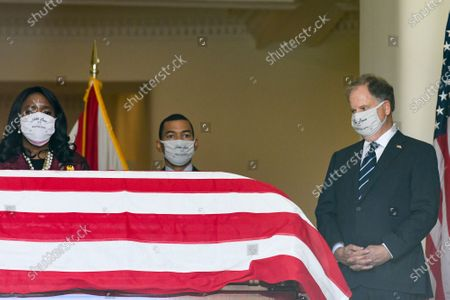 Rep. Terry Sewell, left to right, Montgomery Mayor Steven Reed and U.S. Sen. Doug Jones stand near the body of Congressman John Lewis after arrival to the Alabama Capitol, in Montgomery, Ala