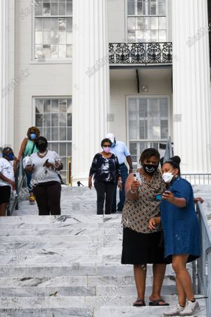 Stock Photo of Michelle Harris, left, and Jennifer Cunningham, both of Montgomery, take a selfie outside the Alabama Capitol after viewing the body of Congressman John Lewis, in Montgomery, Ala