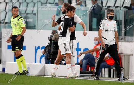 Juventus' Paulo Dybala, right, leaves the field injured to be replaced by Mattia De Sciglio during the Serie A soccer match between Juventus and Sampdoria at the Allianz stadium in Turin, Italy