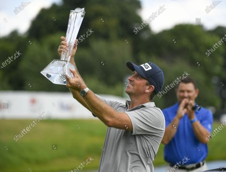 Michael Thompson of Sea Island, Georgia holds the trophy  after finishing 19-under par and winning the 3M Open golf tournament at the TPC Twin Cities course in Blaine, Minnesota, USA, 26 July 2020.
