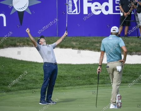 Michael Thompson (L) of Sea Island, Georgia  celebrates after finishing 19-under par and winning the 3M Open golf tournament as Richy Werenski (R) of West Palm Beach, Florida, looks on at the TPC Twin Cities course in Blaine, Minnesota, USA, 26 July 2020.