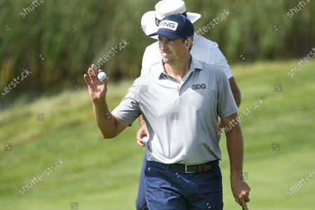 Michael Thompson of Sea Island, Georgia acknowledges the crowd after making a birdie on the sixteenth hole during the 3M Open golf tournament at the TPC Twin Cities course in Blaine, Minnesota, USA, 26 July 2020. Thompson won with a 19-under par.