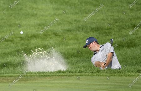 Michael Thompson of Sea Island, Georgia hits out of the bunker on the sixteenth hole during the 3M Open golf tournament at the TPC Twin Cities course in Blaine, Minnesota, USA, 26 July 2020. Thompson won with a 19-under par.