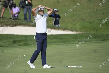Charl Schwartzel of Johannesburg, South Africa, reacts after missing a putt on the eighteenth hole and finishing tied for third during the 3M Open golf tournament at the TPC Twin Cities course in Blaine, Minnesota, USA, 26 July 2020. Thompson won with a 19-under par.