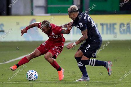 Toronto FC forward Erickson Gallardo (9) works against New York City FC defender Ronald Matarrita during the second half of an MLS soccer match, in Kissimmee, Fla