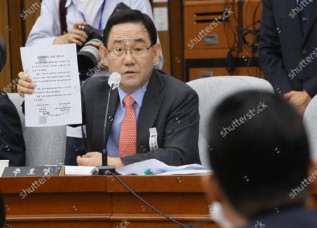 Joo Ho-young, floor leader of the main opposition United Future Party, shows off a copy of a secret inter-Korean agreement carrying the signature of National Intelligence Service (NIS) chief nominee Park Jie-won during his confirmation hearing at the intelligence committee of the National Assembly in Seoul  South Korea, 27 July 2020. Park denied that it was his signature, saying, 'I don't remember (signing the agreement).' He visited the North as a presidential envoy of then-President Kim Dae-jung in April 2000 prior to the inter-Korean summit held in Pyongyang on June 15 that year. According to the disclosed accord, signed on April 8, Park agreed to secretly provide US dollars 500 million to the North based on a humanitarian spirit. Rep. Joo Ho-young, floor leader of the main opposition United Future Party, disclosed the accord.