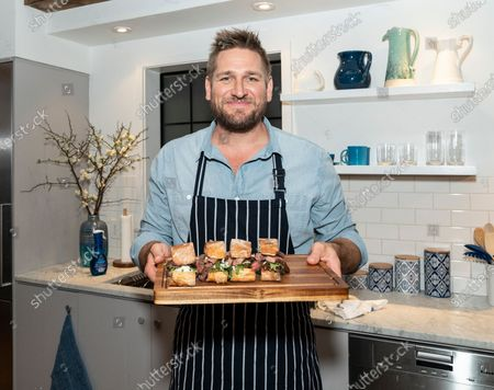 Australian celebrity chef Curtis Stone cooking ribeye steak sandwiches and wash dishes with new Dawn dish spray at Home Studios 873 Broadway
