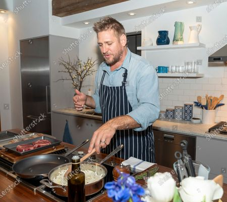 Australian celebrity chef Curtis Stone cooking ribeye steak sandwiches and washes dishes with new Dawn dish spray at Home Studios 873 Broadway