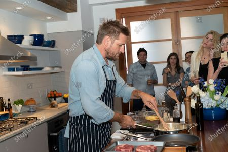Stock Picture of Australian celebrity chef Curtis Stone cooking ribeye steak sandwiches and washes dishes with new Dawn dish spray at Home Studios 873 Broadway