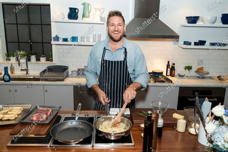 Stock Photo of Australian celebrity chef Curtis Stone cooking ribeye steak sandwiches and washes dishes with new Dawn dish spray at Home Studios 873 Broadway
