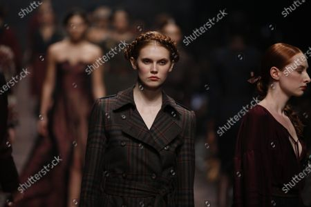 Models on the catwalk at the MBFW in the Kraftwerk Berlin present the autumn/winter 2020/21 collection by the designer Lena Hoschek.