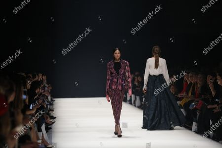 Stock Image of Models on the catwalk at the MBFW in the Kraftwerk Berlin present the autumn / winter 2020/21 collection by the designer Irene Luft.