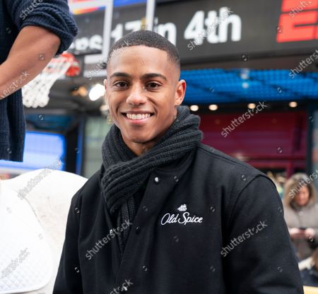 Stock Image of Actor Keith Powers poses during Old Spice products promotion on Times Square