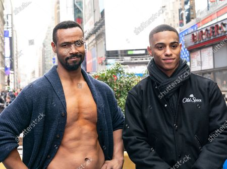 Actors Isaiah Mustafa and Keith Powers pose during Old Spice products promotion on Times Square