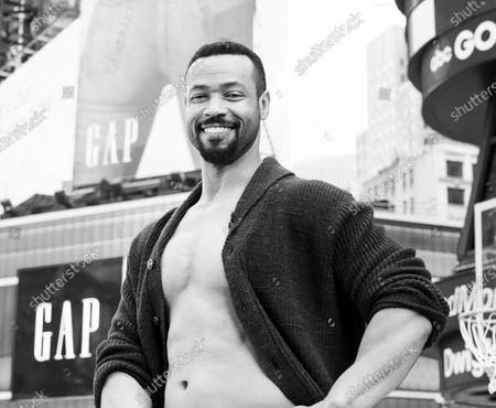 Actor Isaiah Mustafa poses during Old Spice products promotion on Times Square
