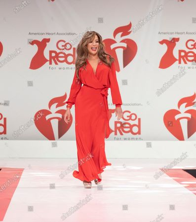 Sunny Hostin wearing dress by Fame and Partners walks runway for The American Heart Association's Go Red For Women Red Dress Collection 2020 at Hammerstein Ballroom