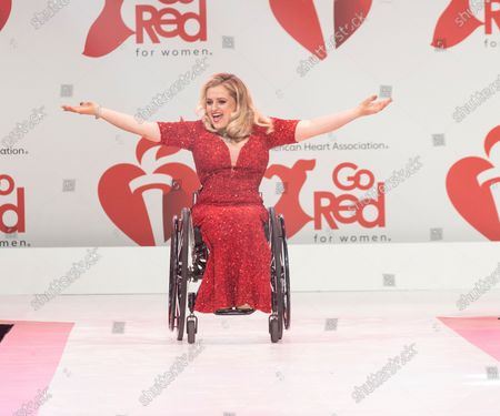 Ali Stroker wearing dress by Theia Couture walks runway for The American Heart Association's Go Red For Women Red Dress Collection 2020 at Hammerstein Ballroom