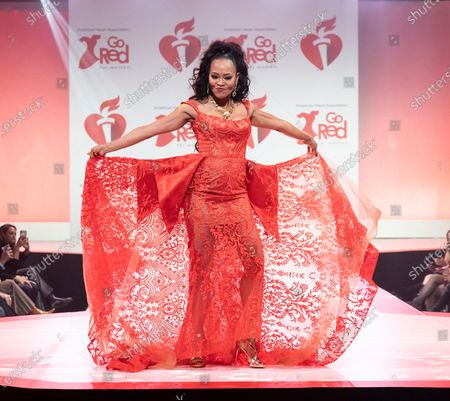 Robin Givens wearing dress by NF by Nour walks runway for The American Heart Association's Go Red For Women Red Dress Collection 2020 at Hammerstein Ballroom
