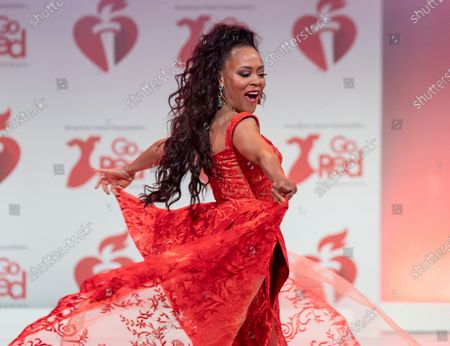 Stock Picture of Robin Givens wearing dress by NF by Nour walks runway for The American Heart Association's Go Red For Women Red Dress Collection 2020 at Hammerstein Ballroom
