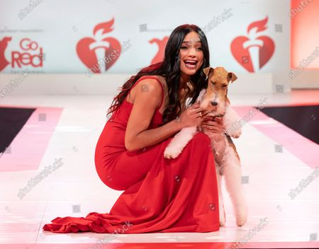 Stock Photo of Rachel Smith wearing dress by Oliver Tolentino and dog King walks runway for The American Heart Association's Go Red For Women Red Dress Collection 2020 at Hammerstein Ballroom