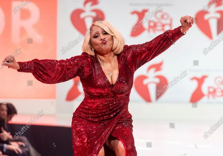 Stock Photo of Darlene Love wearing dress by Teri Jon walks runway for The American Heart Association's Go Red For Women Red Dress Collection 2020 at Hammerstein Ballroom