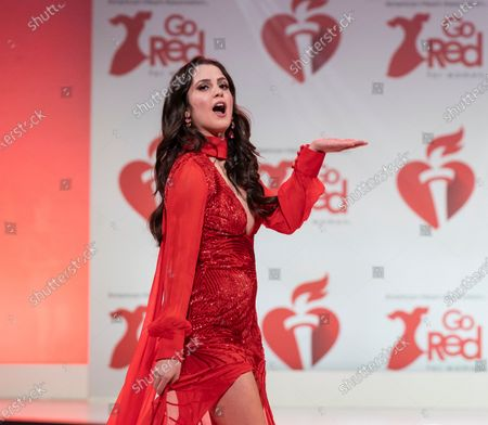 Laura Marano wearing dress by Maison Alexandrine walks runway for The American Heart Association's Go Red For Women Red Dress Collection 2020 at Hammerstein Ballroom