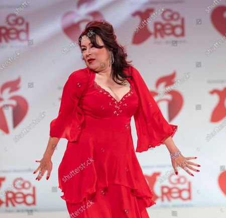 Jennifer Tilly wearing dress by Nicole Miller walks runway for The American Heart Association's Go Red For Women Red Dress Collection 2020 at Hammerstein Ballroom