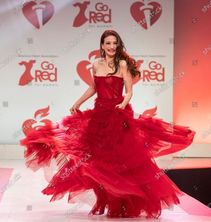 Stock Photo of Marin Hinkle wearing dress by J. Mendel walks runway for The American Heart Association's Go Red For Women Red Dress Collection 2020 at Hammerstein Ballroom