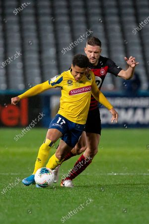 Central Coast Mariners forward Samuel Silvera (17) is fouled by Western Sydney Wanderers defender Matthew Jurman (6)