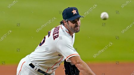 Stock Picture of Houston Astros starting pitcher Justin Verlander throws during the first inning of a baseball game against the Seattle Mariners, in Houston