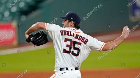 Houston Astros starting pitcher Justin Verlander throws during the first inning of a baseball game against the Seattle Mariners, in Houston