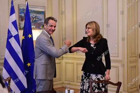 Handshake of Greek Prime Minister Kyriakos Mitsotakis (left) with Deputy Prime Minister and Minister of Foreign Affairs of Bulgaria Ekaterina Zaharieva (right), during their meeting.