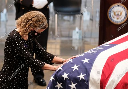Rep. Debbie Wasserman Schultz, D-Fla., pays her respects to Rep. John Lewis, D-Ga., as he lies in state in the Capitol Rotunda, in Washington