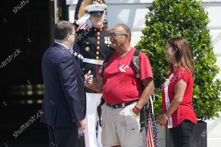 Stock Image of United States Secretary of Veterans Affairs (VA) Robert Wilkie welcome Terry Sharpe, the Walking Marine to the White House in Washington, DC. Terry Sharpe planned his July 2020 Walk to raise awareness of the current Veteran suicide rate, which stands at 22 per day.