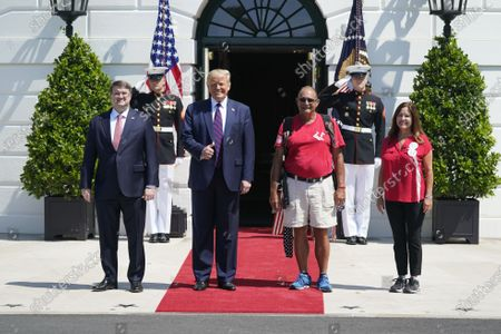 United States President Donald J. Trump and United States Secretary of Veterans Affairs (VA) Robert Wilkie welcome Terry Sharpe, the Walking Marine to the White House in Washington, DC. Terry Sharpe planned his July 2020 Walk to raise awareness of the current Veteran suicide rate, which stands at 22 per day.