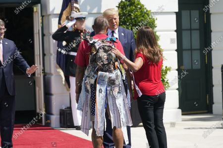 United States President Donald J. Trump welcomes Terry Sharpe, the Walking Marine to the White House in Washington, DC. Terry Sharpe planned his July 2020 Walk to raise awareness of the current Veteran suicide rate, which stands at 22 per day.