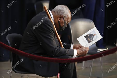 Democratic Representative from Illinois Danny Davis reads the program prior to the start of the ceremony preceding the lying in state of US Representative from Georgia John Lewis in the Rotunda of the US Capitol in Washington, DC, USA, 27 July 2020.