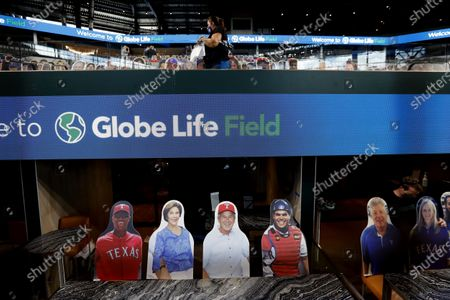 In this photo made, cutouts of, from front left, Adrian Beltre, former first Lady Laura Bush and former President George W. Bush and Ivan Rodriguez sit in a suite at the Texas Rangers baseball stadium Globe Life Field in Arlington, Texas. The Texas Rangers' new stadium isn't retro and designers wanted the first next-generation ballpark