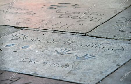"""Olivia de Havilland's 1952 inscription appears in cement in front of the TCL Chinese Theatre, in Los Angeles. The two-time Oscar winner, best known for her role as the kindly Melanie in """"Gone With the Wind,"""" died Sunday at her home in Paris. She was 104"""
