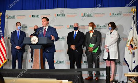 Rep. Mario Díaz-Balart, Dr. Stephen Hahn, FDA Commissioner, Florida Gov. Ron DeSantis, U.S. Vice President Mike Pence, Dr. Henri Ford, Dean and Chief Academic Officer, University of Miami Miller School of Medicine and Dr. Susanne Doblecki-Lewis, Principal Investigator, University of Miami Miller School of Medicine participate in a press conference with  U.S. Vice President Mike Pence to mark the beginning of Phase III trials for a Coronavirus vaccine at the University of Miami Miller School of Medicine, Don Soffer Clinical Research Center. The Vice President participate in a roundtable with Florida Gov. Ron DeSantis, FDA Commissioner, university leadership and researchers on the progress of a Coronavirus vaccine.