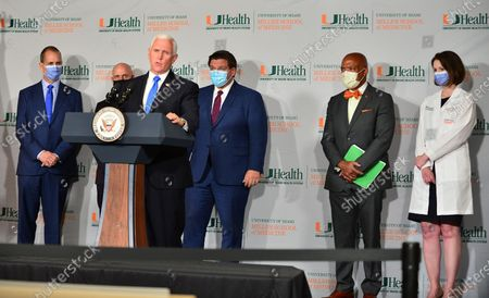 Rep. Mario Díaz-Balart, Dr. Stephen Hahn, FDA Commissioner,  U.S. Vice President Mike Pence, Florida Gov. Ron DeSantis,Dr. Henri Ford, Dean and Chief Academic Officer, University of Miami Miller School of Medicine and Dr. Susanne Doblecki-Lewis, Principal Investigator, University of Miami Miller School of Medicine participate in a press conference with  U.S. Vice President Mike Pence to mark the beginning of Phase III trials for a Coronavirus vaccine at the University of Miami Miller School of Medicine, Don Soffer Clinical Research Center. The Vice President participate in a roundtable with Florida Gov. Ron DeSantis, FDA Commissioner, university leadership and researchers on the progress of a Coronavirus vaccine.