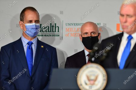 Stock Picture of Rep. Mario Díaz-Balart, Dr. Stephen Hahn, FDA Commissioner and U.S. Vice President Mike Pence participate in a press conference with U.S. Vice President Pence to mark the beginning of Phase III trials for a Coronavirus vaccine at the University of Miami Miller School of Medicine, Don Soffer Clinical Research Center