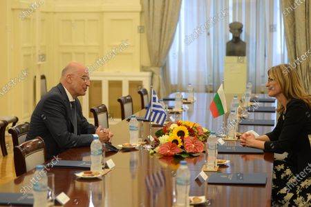 Greek Minister of Foreign Affairs Nikos Dendias (left) with Deputy Prime Minister and Minister of Foreign Affairs of Bulgaria Ekaterina Zaharieva (right), during their meeting.