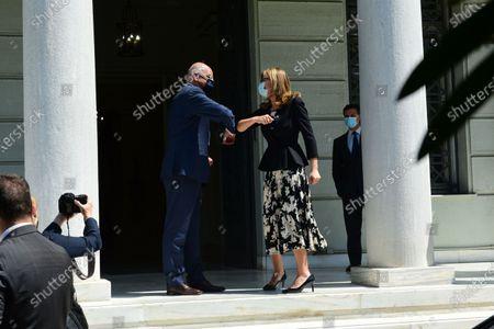 Handshake of Greek Minister of Foreign Affairs Nikos Dendias (left) with Deputy Prime Minister and Minister of Foreign Affairs of Bulgaria Ekaterina Zaharieva (right).