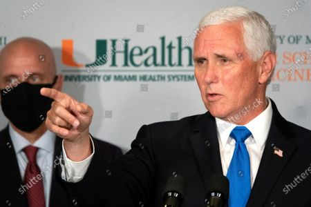 Vice President Mike Pence speaks in the Press Briefing after the roundtable with university leadership and researchers on the progress of a Coronavirus vaccine, at the UHealth Don Soffer Clinical Research Center in Miami, Florida, USA, 27 July 2020. Pence traveled to Miami to mark the beginning of Phase III trials for a Coronavirus vaccine. Next to Pence is the Dr. Stephen M. Hahn, Commissioner of Food and Drugs Administration (FDA).
